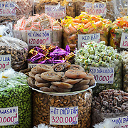 Food and candy for sale at markets in the Cho Lon in Ho Chi Minh City (Saigon), Vietnam.