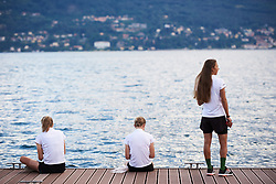 Waowdeals Pro Cycling sit out on a jetty on Lago Maggiore at Giro Rosa 2018 - Team Presentation in Verbania, Italy on July 5, 2018. Photo by Sean Robinson/velofocus.com