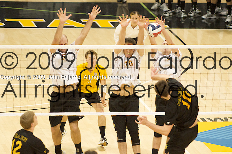 03Jan09 Long Beach, CA-  Joel Schmuland is blocked at the net by the three man front of Mike Klipsch, Rory Jones and Kyle Friend.  Alberta lost the match to the 49ers three games to one.