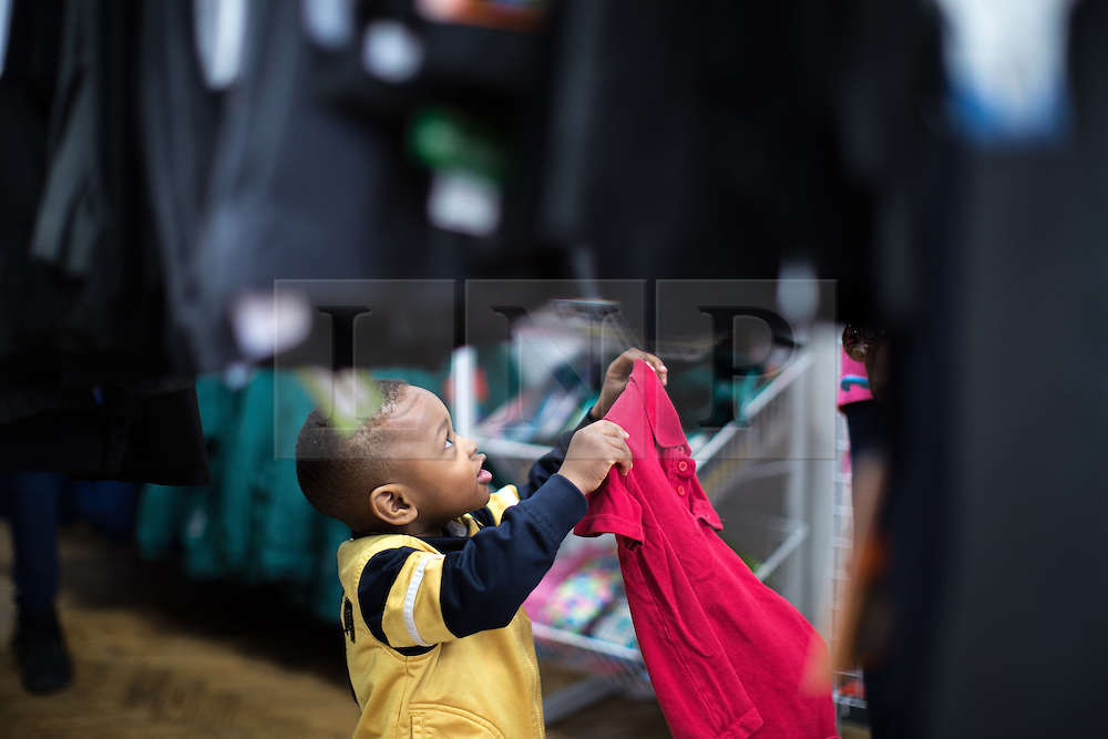 © Licensed to London News Pictures . Manchester , UK . The Wood Street Mission is opening its community shop today (Tuesday 16th August 2016) , enabling families on a low income to get school uniform and other school necessities for free , in time for the new school year . Founded by Methodist Minister Alfred Alsop in 1869 , the Mission's aim is to alleviate the effects of poverty on children and families in Manchester and Salford . Photo credit : Joel Goodman/LNP
