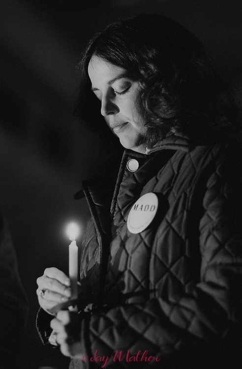 Lois Windhorst, head of the Mothers Against Drunk Driving chapter in Louisville, Kentucky at a candlelight vigil remembering victims.  December 12, 1982.
