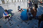 Harajuku girls poses for the cameras on Meiji bridge Tokyo Japan