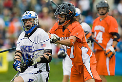 Duke attackman Matt Danowski (40) is defended by Virginia defenseman Ken Clausen (27).  The #2 ranked Duke Blue Devils defeated the #3 ranked Virginia Cavaliers 11-9 in the finals of the Men's 2008 Atlantic Coast Conference tournament at the University of Virginia's Klockner Stadium in Charlottesville, VA on April 27, 2008.