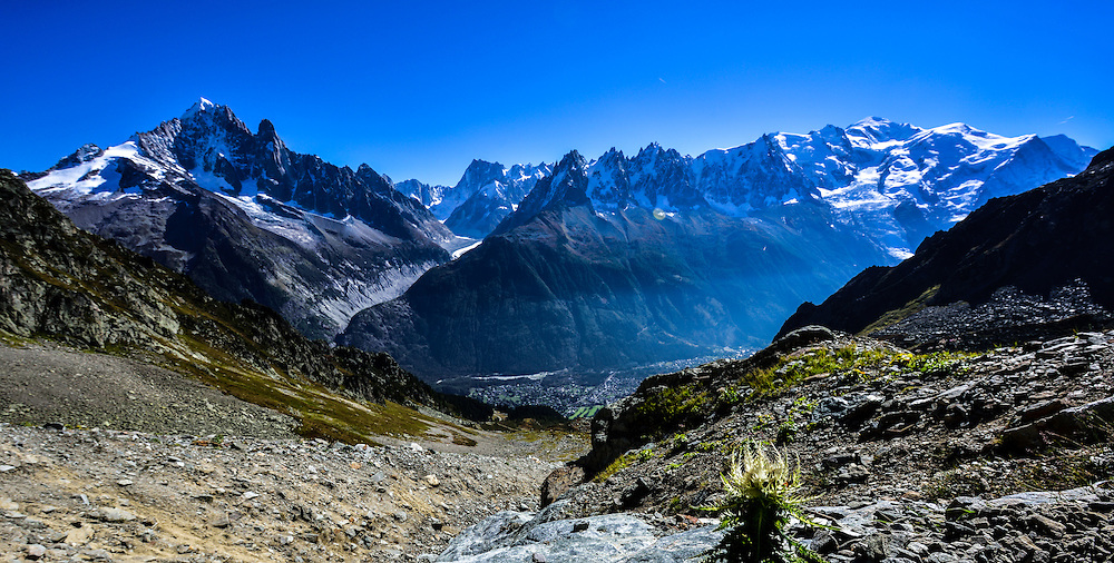 """The Alps are the highest and most extensive mountain range system that lies entirely in Europe, stretching approximately 1,200 kilometres (750mi) across eight Alpine countries: Austria, France, Germany, Italy, Liechtenstein, Monaco, Slovenia, and Switzerland. The mountains were formed over tens of millions of years as the African and Eurasian tectonic plates collided. Extreme shortening caused by the event resulted in marine sedimentary rocks rising by thrusting and folding into high mountain peaks such as Mont Blanc and the Matterhorn. Mont Blanc spans the French–Italian border, and at 4,810m (15,781ft) is the highest mountain in the Alps. The Alpine region area contains about a hundred peaks higher than 4,000m (13,123ft), known as the """"four-thousanders""""."""