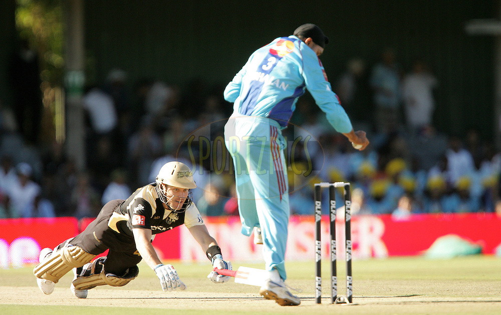 EAST LONDON, SOUTH AFRICA - 1 May 2009. Morne Van Wyk just makes it back before being run out by Harbhajan Singh  during the  IPL Season 2 match between the Mumbai Indians and the Kolkata Knight Riders held at Buffalo Park in East London. South Africa..
