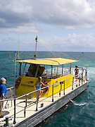 The semi-submarine takes on passengers from the Big Cat at Green Island, along the Great Barrier Reef, near Cairns, QLD, Australia.