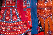 Traditional muslim lehanga dresses on display at stall in bazaar in Jaipur, Rajasthan, Northern India