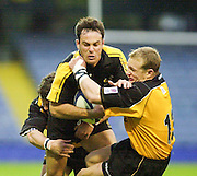 Wycombe, Bucks <br /> Zurich Premiership 11-11-2001<br /> London Wasps V Newcastle Falcons<br /> Wasps, Fraser Waters is tackled by Falcons's Jamie Noon  [Mandatory Credit;Peter SPURRIER/Intersport Image]