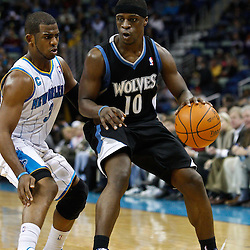 February 7, 2011; New Orleans, LA, USA; Minnesota Timberwolves point guard Jonny Flynn (10) is guarded by New Orleans Hornets point guard Chris Paul (3) during the third quarter at the New Orleans Arena. The Timberwolves defeated the Hornets 104-92.  Mandatory Credit: Derick E. Hingle