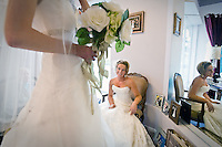 JEROME A. POLLOS/Press..Kelly Lattin watches Sophie Faller as she models a wedding gown during a fitting Tuesday at Storybook Bridal at the Coeur d'Alene Resort Plaza in preparation for Saturday's bridal show.
