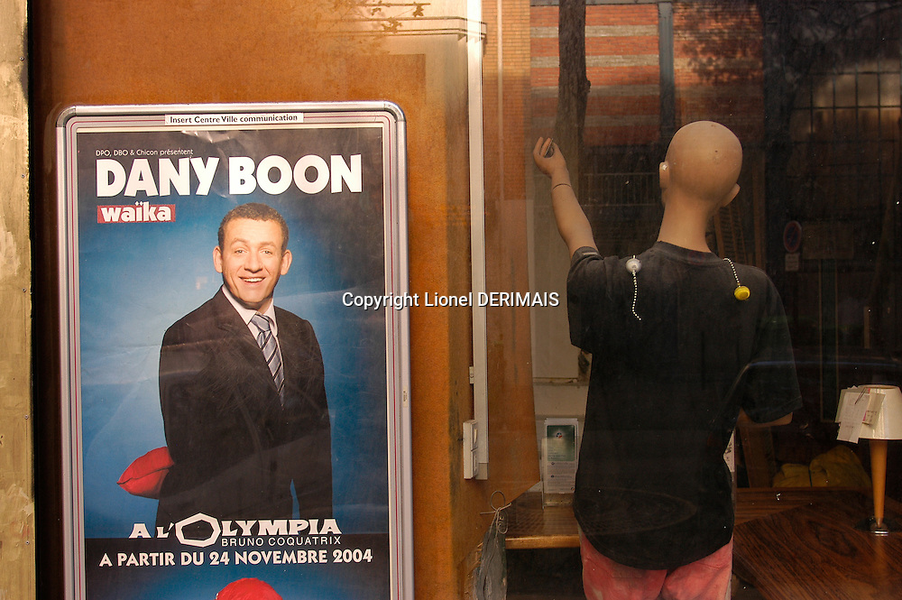 Dany Boon poster in a shop window, Paris, France.