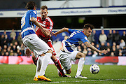 Queens Park Rangers midfielder Alejandro Faurlín gets a block in to stop Middlesbrough FC striker Jordan Rhodes' (9)  shot during the Sky Bet Championship match between Queens Park Rangers and Middlesbrough at the Loftus Road Stadium, London, England on 1 April 2016. Photo by Andy Walter.