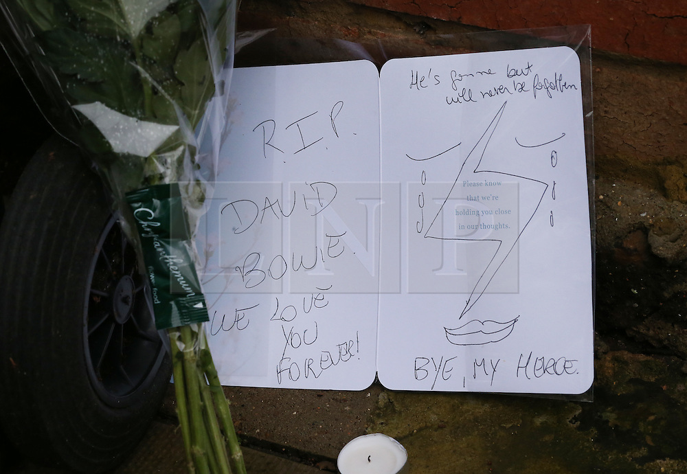 © Licensed to London News Pictures. 11/01/2016. London, UK. Flowers and a card are placed at the Brixton house that David Bowie lived in. The Death of David Bowie, who was born in Brixton, has been announced today.  Photo credit: Peter Macdiarmid/LNP