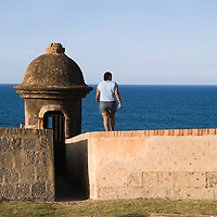 Woman standing by turret of San Cristobal Castle, Old San Juan, Puerto Rico.