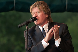 Peter Noone, clapping & singing, performing with Herman's Hermits at the Hamden Free Summer Concert Series. July 11, 2009 Town Center Park at Meadowbrook. Photo tweaked August 2011.