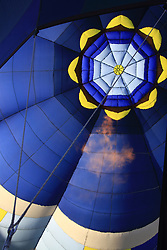 the inside of a blue hot air balloon with fire