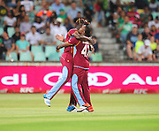 Darren Sammy celebrates with Dwayne Bravo , West Indies during the 2015 KFC T20 International Series cricket match between South Africa and West Indies at the Kingsmead Stadium in Durban on the 14th of January 2015<br /> <br /> ©Sabelo Mngoma/BackpagePix