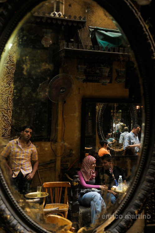 The famous tea and coffee house (ahwa) Al-Fischawi, in the hearth of one of largest Middle East bazaars, Khan el Khalili. Seller of animals stuffed with straw. Cairo's ahwa (the traditional coffeehouse) are for Cairo what the pub is to London or caffè to Rome. Once the ahwa was the main place for entairnement, a animated place where Cairo's men socialised playing chess, backgammon or domino, reading newspapers or watching TV, drinking Turkish coffee and shai (tea) with mint or smoking a sheesha, the tradional waterpipe. Some ahwa are meeting places for people loving chess or remembering famous Egyptian singer Oum Kalthoum. Today Cairo is changed and everybody is just too busy to drink coffee in a ahwa, so western style coffee shops are much more than traditional ahwa.