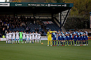 Both teams observe a minutes silence before the EFL Sky Bet League 1 match between Wycombe Wanderers and Peterborough United at Adams Park, High Wycombe, England on 3 November 2018.
