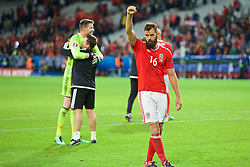 LILLE, FRANCE - Friday, July 1, 2016: Wales' Joe Ledley salutes the supporters as they celebrate the 3-1 victory against Belgium at full time after the UEFA Euro 2016 Championship Quarter-Final match at the Stade Pierre Mauroy. (Pic by Paul Greenwood/Propaganda)