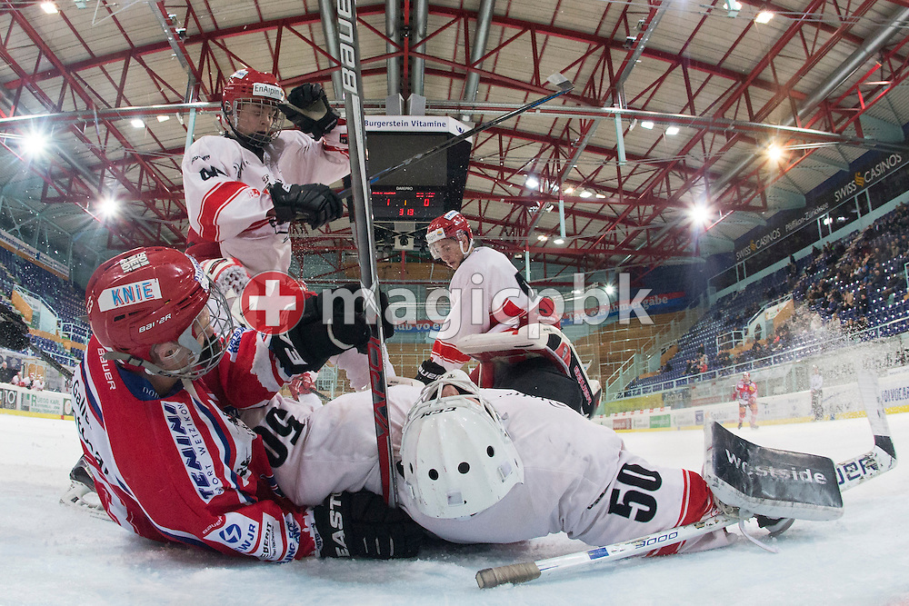 Rapperswil-Jona Lakers forward Dimitri Beer (L) against EHC Visp goaltender Hoel Ballestraz and Adrien Echenard (2nd L) during the third Elite B 1/2 final Playoff ice hockey game between Rapperswil-Jona Lakers and EHC Visp held at the SGKB Arena in Rapperswil, Switzerland, Friday, Mar. 3, 2017. (Photo by Patrick B. Kraemer / MAGICPBK)