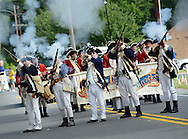 A group of reenactors kick off the start of the parade with a volley of gunfire during the Middletown Township 4th of July Independence Day Parade Monday July 4, 2016 in Middletown Township, Pennsylvania. (Photo by William Thomas Cain)