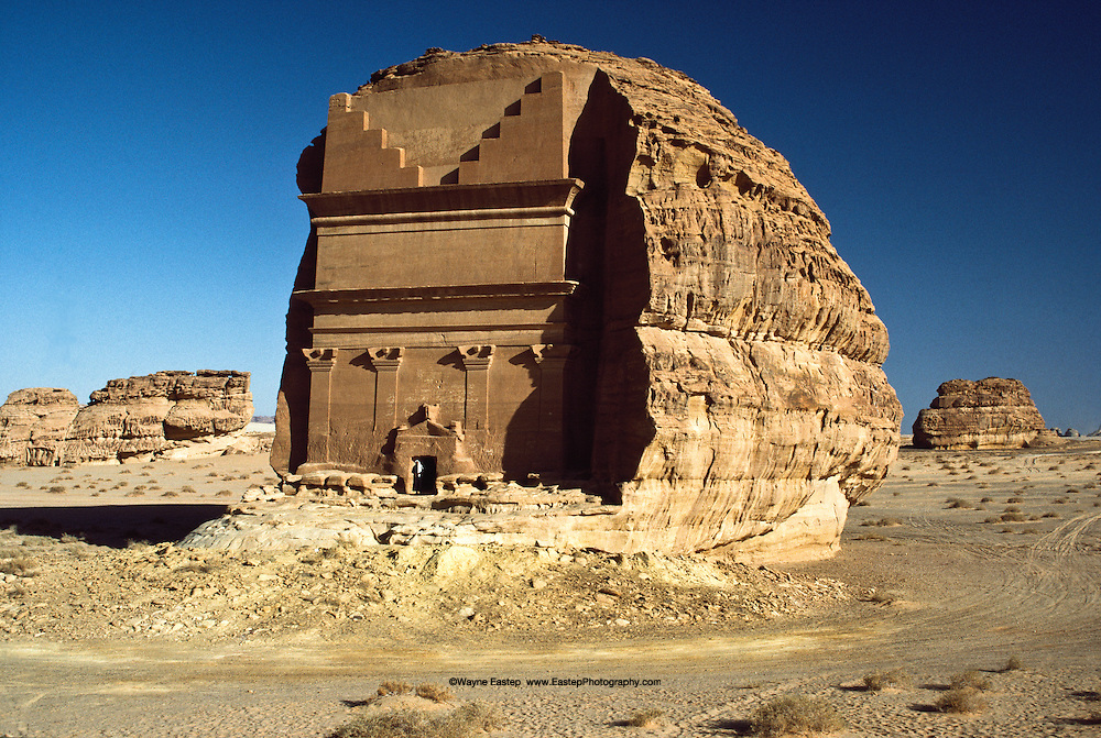 Isolated tomb at Mada'in Saleh, wealthy Nabataens were buried in splendor in tomb carved in rock and long since robbed of valuables.               The archeological site of Al-Hijr (Madain Saleh) is the first UNESCO World Heritage Site in  Saudi Arabia.  It is a major center of the Nabataen civilization.  It is the largest Nabataen site south of Petra in Jordan.  It bears testimony to teh Nabataen civiliztkion between the 2nd and 3rd centuries BC and pre-Islamic period in the 1st century AD.