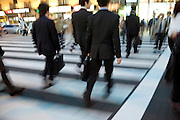 young businesspeople walking across a  zebra crossing during their evening commute Tokyo Japan