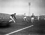 29/04/1962<br /> 04/29/1962<br /> 29 April 1962<br /> Shamrock Rovers v Shelbourne in the F.A.I. Cup Final at Dalymount Park, Dublin. Rovers goalie Henderson about to gather the ball as Hannigan (right) Shelbourne insode right and Farrell, (centre) Shamrock Rovers Left half run in.