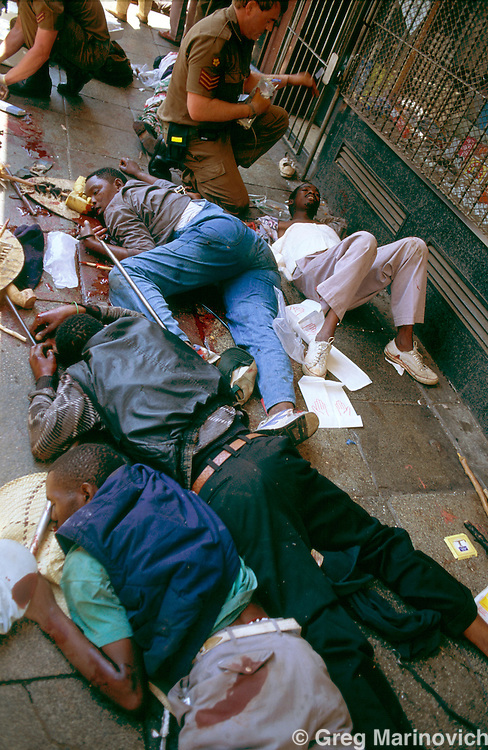 Johannesburg, South Africa, 1994.  IFP wounded and dead after  African National Congress guards opened fire on Inkatha Freedom Party marchers when they approached the ANC headquarters of Shellhouse, Johannesburg 1994. Many IFP suppor