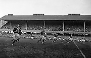 O'Reilly, Irish right wing back, in possession, left, with Irish backs Flynn and Hewitt, calling for a pass,..Irish Rugby Football Union, Ireland v France, Five Nations, Landsdowne Road, Dublin, Ireland, Saturday 18th April, 1959,.18.4.1959, 4.18.1959,..Referee- D G Walters, Welsh Rugby Union, ..Score- Ireland 9 - 5 France, ..Irish Team, ..N J Henderson, Wearing number 15 Irish jersey, Full Back, N.I.F.C, Rugby Football Club, Belfast, Northern Ireland, ..A J O'Reilly, Wearing number 14 Irish jersey, Right Wing, Old Belvedere Rugby Football Club, Dublin, Ireland, and, Leicester Rugby Football Club, Leicester, England, ..M K Flynn, Wearing number 13 Irish jersey, Right Centre, Wanderers Rugby Football Club, Dublin, Ireland, ..D Hewitt, Wearing number 12 Irish jersey, Left centre, Queens University Rugby Football Club, Belfast, Northern Ireland,..N H Brophy, Wearing number 11 Irish jersey, Left wing, University College Dublin Rugby Football Club, Dublin, Ireland, ..M A F English, Wearing number 10 Irish jersey, Outside Half, Bohemians Rugby Football Club, Limerick, Ireland,..A A Mulligan, Wearing number 9 Irish jersey, Scrum Half, London Irish Rugby Football Club, Surrey, England, ..B G Wood, Wearing number 1 Irish jersey, Forward, Garryowen Rugby Football Club, Limerick, Ireland, ..A R Dawson, Wearing number 2 Irish jersey, Captain of the Irish team, Forward, Wanderers Rugby Football Club, Dublin, Ireland, ..S Millar, Wearing number 3 Irish jersey, Forward, Ballymena Rugby Football Club, Antrim, Northern Ireland,..W A Mulcahy, Wearing number 4 Irish jersey, Forward, University College Dublin Rugby Football Club, Dublin, Ireland, ..M G Culliton, Wearing number 5 Irish jersey, Forward, Wanderers Rugby Football Club, Dublin, Ireland, ..N Murphy, Wearing number 6 Irish jersey, Forward, Cork Constitution Rugby Football Club, Cork, Ireland,..P J A O' Sullivan, Wearing  Number 7 Irish jersey, Forward, Galwegians Rugby Football Club, Galway, Ireland,..J R Kavanagh, Wearing nu