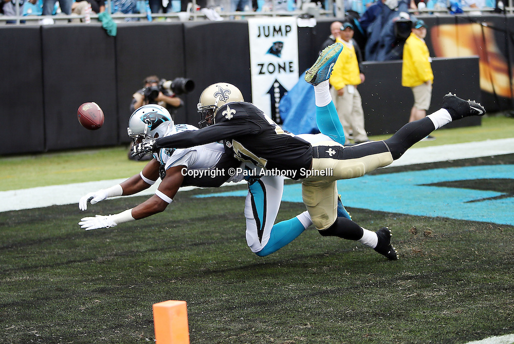 New Orleans Saints cornerback Damian Swann (27) breaks up an end zone pass intended for diving Carolina Panthers wide receiver Devin Funchess (17) during the 2015 NFL week 3 regular season football game against the Carolina Panthers on Sunday, Sept. 27, 2015 in Charlotte, N.C. The Panthers won the game 27-22. (©Paul Anthony Spinelli)