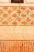 MARRAKESH, MOROCCO - 19TH APRIL 2016 - Abstract close-up of cracks appearing in the walls of the exterior of the Zaouia / zawiya burial tomb shrine site of Sidi Abdullah al-Ghazwani, Marrakesh, Morocco.