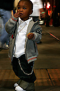 February 27th 2006. New Orleans, Louisiana. United States..A kid watches a Lundi Gras' evening Parade on Canal Street.