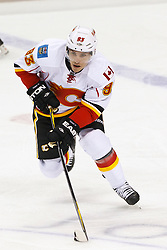 Jan 17, 2012; San Jose, CA, USA; Calgary Flames left wing Mike Cammalleri (93) skates with the puck against the San Jose Sharks during the second period at HP Pavilion. San Jose defeated Calgary 2-1 in shootouts. Mandatory Credit: Jason O. Watson-US PRESSWIRE