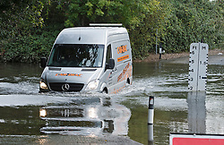 © London News Pictures. 17/10/2012. Charvil, UK. A van driving past depth indicators at two foot at a ford on the River Loddon at Charvil in Berkshire on October 17, 2012 following heavy rain last night. Photo credit : Ben Cawthra /LNP