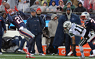 (Foxboro, MA 122416) Patriots Malcom Butler pulls in one of his interceptions. Staff photo Chris Christo