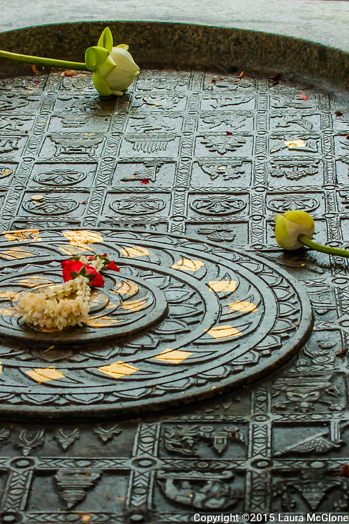 Lotus flower offerings on a table in a temple in Bangkok, Thailand