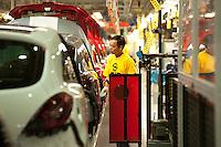 04 MAY 2009, EISENACH/GERMANY:<br /> Mitarbeiter bei der Fertigung eines Opel Corsa im Opel Werk Eisenach, Opel Eisenach GmbH<br /> IMAGE: 20090504-01-<br /> KEYWORDS: Fliessband, Auto, KFZ, Wagen, Arbeiter, Worker
