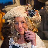 VENICE, ITALY - FEBRUARY 19:  A young woman wearing a  19th Century waitress costume poses witha glass of wine byr the  wine fountain in St Mark Square on February 19, 2011 in Venice, Italy. The fountain pouring wine features today during the Gran brindisi a Venezia or Grand Toast in Venice, the opening ceremony of this year Carnival .  (