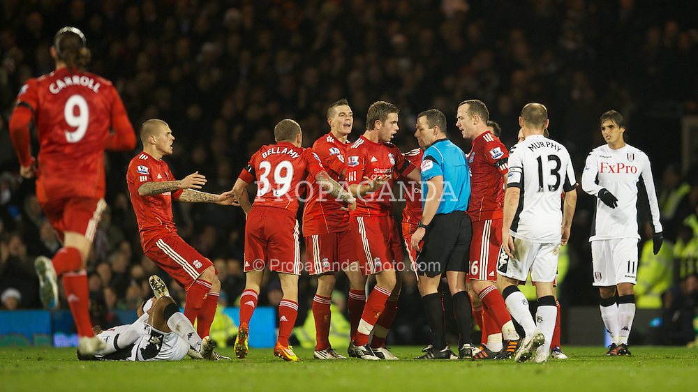 LONDON, ENGLAND - Monday, December 5, 2011: Liverpool players surround the referee Kevin Friend after he sent off Jay Spearing during the Premiership match against Fulham at Craven Cottage. (Pic by David Rawcliffe/Propaganda)