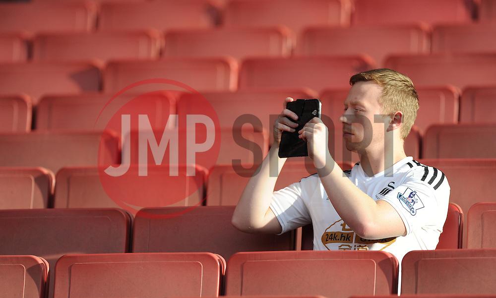 Swansea City fans takes a picture inside the Emirates Stadium. - Photo mandatory by-line: Alex James/JMP - Mobile: 07966 386802 - 11/05/2015 - SPORT - Football - London - Emirates Stadium - Arsenal v Swansea City - Barclays Premier League