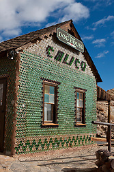 Exterior of the Bottle House / Dorsey's Dog House, made of glass bottles, Calico, California, United States of America