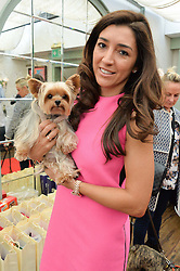FABIANA ECCLESTONE and her dog Oscar at a party hosted by Lulu Guinness and Daphne's to launch Lulu's Designer Dog Bowl and to mark Daphne's allowing dogs through it's doors, held at Daphne's, Draycott Avenue, London on 28th June 2016.