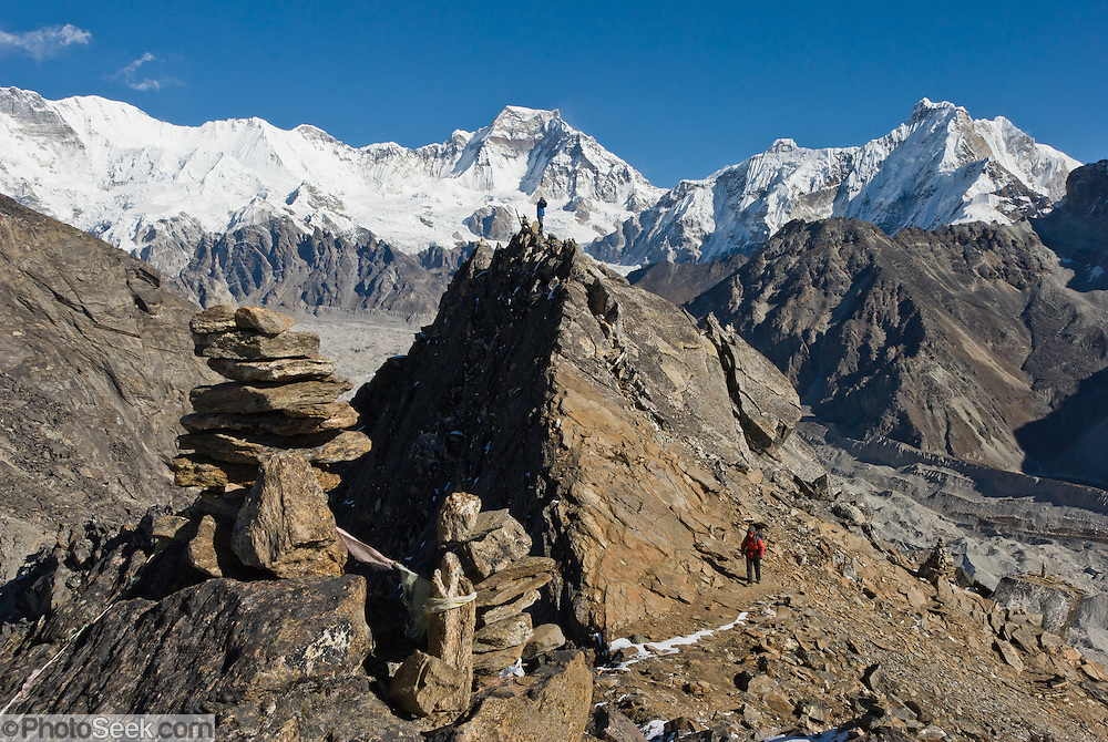 This view is from Gokyo Ri (17,575 feet / 5357 meters above sea level), a peak, in the Khumbu region of the Nepal Himalaya, in Sagarmatha National Park. Gokyo Ri is located on ..the west side of the Ngozumpa Glacier, which is the largest glacier in Nepal, and reputed to be the largest in the whole Himalayas. From Gokyo Ri it is possible to see four 8,000 meter peaks - Everest, Lhotse, Makalu, and Cho Oyu. At the base of Gokyo Ri is the village of Gokyo (15,583 feet / 4750 meters), a small cluster of teahouses for trekkers and climbers. Sagarmatha National Park was created in 1976 and honored as a UNESCO World Heritage Site in 1979.