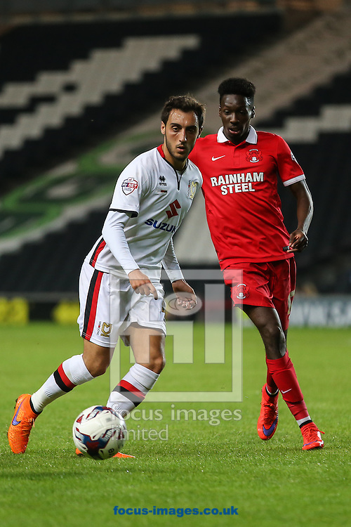 Sergio Aguza of Milton Keynes Dons and Bradley Pritchard of Leyton Orient during the Capital One Cup match at stadium:mk, Milton Keynes<br /> Picture by David Horn/Focus Images Ltd +44 7545 970036<br /> 11/08/2015