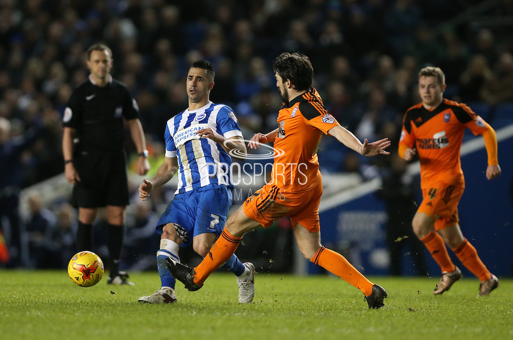 Brighton central midfielder, Beram Kayal (7) snd Ipswich Town midfielder Jonathan Douglas (22) during the Sky Bet Championship match between Brighton and Hove Albion and Ipswich Town at the American Express Community Stadium, Brighton and Hove, England on 29 December 2015.