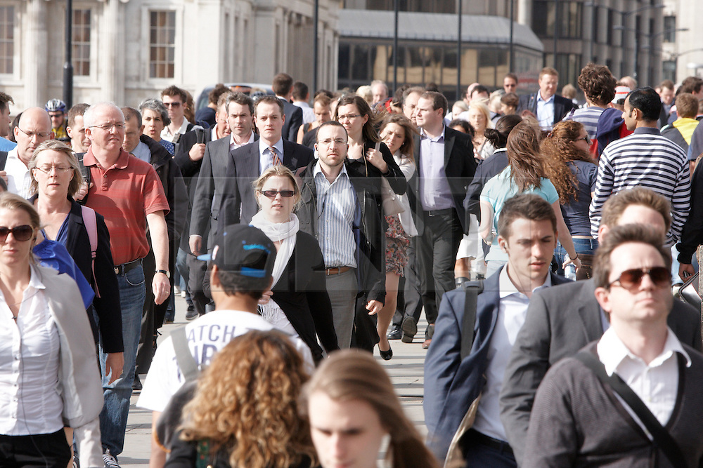 © Licensed to London News Pictures.  30/07/2012. LONDON, UK. Commuters travel through a quieter than usual London Bridge Station as advice to avoid the station is heeded. A predicted clash between the evening rush hour and Olympic event spectators led to the station management making extensive preparations for congestion.  Photo credit :  Cliff Hide/LNP