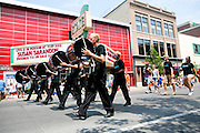 The Oregon Marching Band, collectively known as Shadow Armada, performs in a parade in Traverse City, Michigan on July 14, 2012 for the Traverse City Cherry Festival.