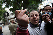 A protester displays the case of a bullet allegedly shoot by the police during a  demonstration in the center of Tunis. People still protest against the partecipation of the Constitutional Democratic Rally, RCD, party of Ben Ali, to the national unity government that today january 18 lost three ministers of the opposition.